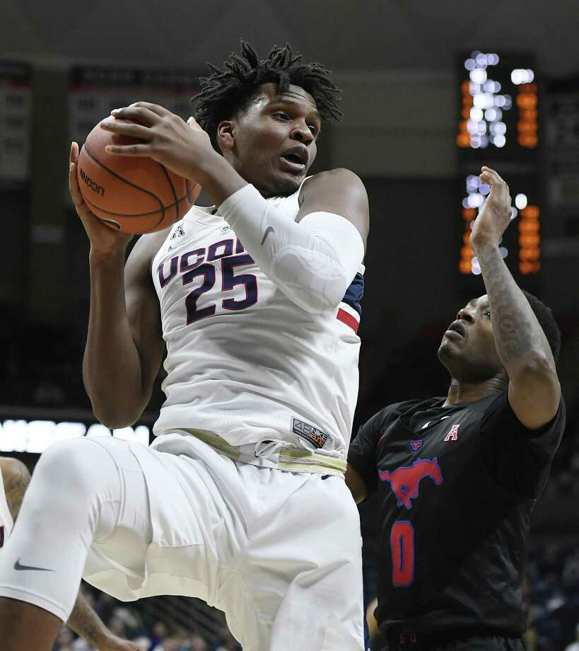 UConn's Josh Carlton pulls down a rebound over SMU's Jahmal McMurray on Jan. 10 in Storrs. Photo: Jessica Hill / Associated Press / Copyright 2019 The Associated Press. All rights reserved