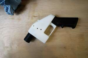 """A 3D printed gun, called the """"Liberator"""", is seen in a factory in Austin, Texas on August 1, 2018. A US gun rights advocate began gearing up for a legal fight Wednesday to be able to publish online blueprints for 3D-printed firearms, as the White House signaled support for a federal judge's decision to block the venture. Cody Wilson's Texas-based company Defense Distributed had briefly made the blueprints available online, but Seattle-based US District Judge Robert Lasnik granted an injunction Tuesday to take the material down. / AFP PHOTO / Kelly WestKELLY WEST/AFP/Getty Images"""