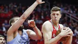 Isaiah Hartenstein, right, one of five Rockets who manned the center position in Monday's win over Memphis, secures a rebound against Grizzlies counterpart Marc Gasol.