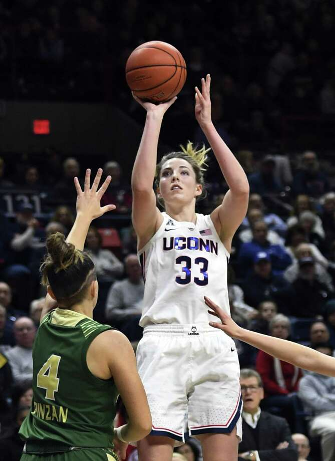 UConn's Katie Lou Samuelson shoots a 3 in the first half game against USF on Sunday in Storrs. Photo: Stephen Dunn / Associated Press / Copyright 2019 The Associated Press. All rights reserved