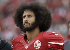 FILE - In this Dec. 11, 2016, file photo, San Francisco 49ers quarterback Colin Kaepernick stands in the bench area during the second half of the team's NFL football game against the New York Jets in Santa Clara, Calif. An arbitrator is sending Kaepernick's grievance with the NFL to trial, denying the league's request to throw out the quarterback's claims that owners conspired to keep him out of the league because of his protests of social injustice. (AP Photo/Marcio Jose Sanchez, File)