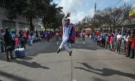 Zach Johnson, a senior at Kashmere High School, leads the school's participants in the 23rd MLK Grande Parade in Houston in 2017. The annual parade, which featured 15 floats and 30 marching bands, kicked off an exciting period for Houston, which would host its third Super Bowl three weeks later. ( Steve Gonzales / Houston Chronicle )