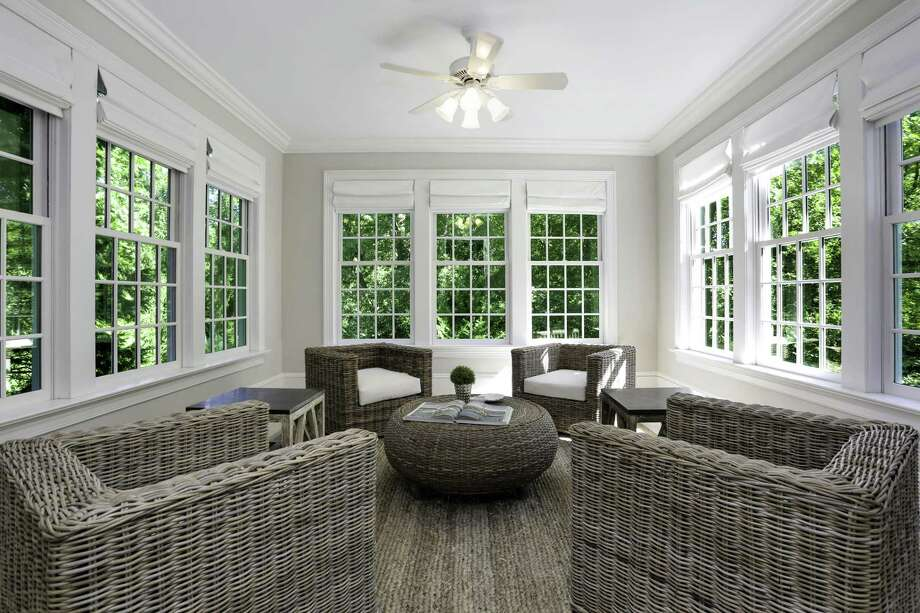 With three exposures, the sunroom at 110 Valley Drive in Greenwich is one of the lovely spaces among the 2018-updated home's living spaces. The six-bedroom colonial is located down a private lane, on 1.62 acres that are just a mile from town. It is listed for $5.2 million. Photo: Houlihan Lawrence