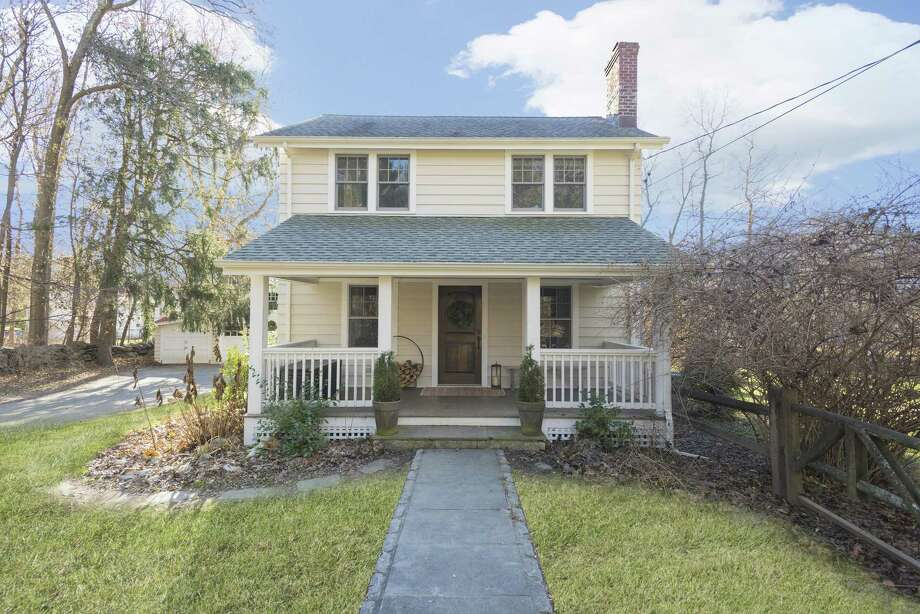 5 Old Rock Lane in West Norwalk is a three-bedroom 1920s-era colonial with great curb appeal on 1.03 acres. The home is listed for $580,000. Photo: Berkshire Hathaway HomeServices New England Properties / ONLINE_CHECK