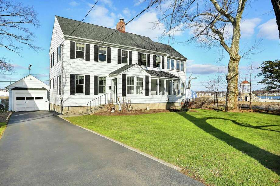 This 1933 colonial in the Shorefront Park Association has been renovated and restored and features three bedrooms and three baths. Photo: William Raveis Real Estate / ONLINE_CHECK