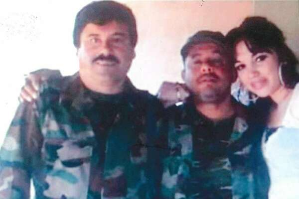 An undated handout photo provided by the United States Attorney's Office, Eastern District of New York shows Joaquín Guzmán Loera, left, the Mexican kingpin known as El Chapo, with Alex Cifuentes Villa, center. For more than a decade, the kingpin evaded capture by staying in a series of mountaintop hide-outs. His days there were recalled by Cifuentes, one of the assistants who lived with him. (United States Attorney's Office, Eastern District of New York via The New York Times) -- EDITORIAL USE ONLY --